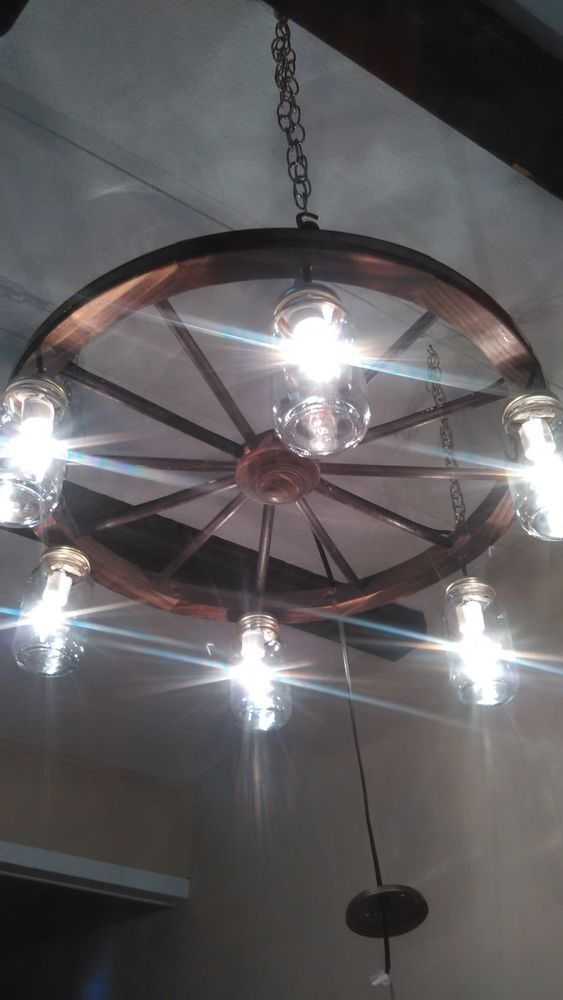 Handcrafted Rustic Wagon Wheel Light Fixture  For the