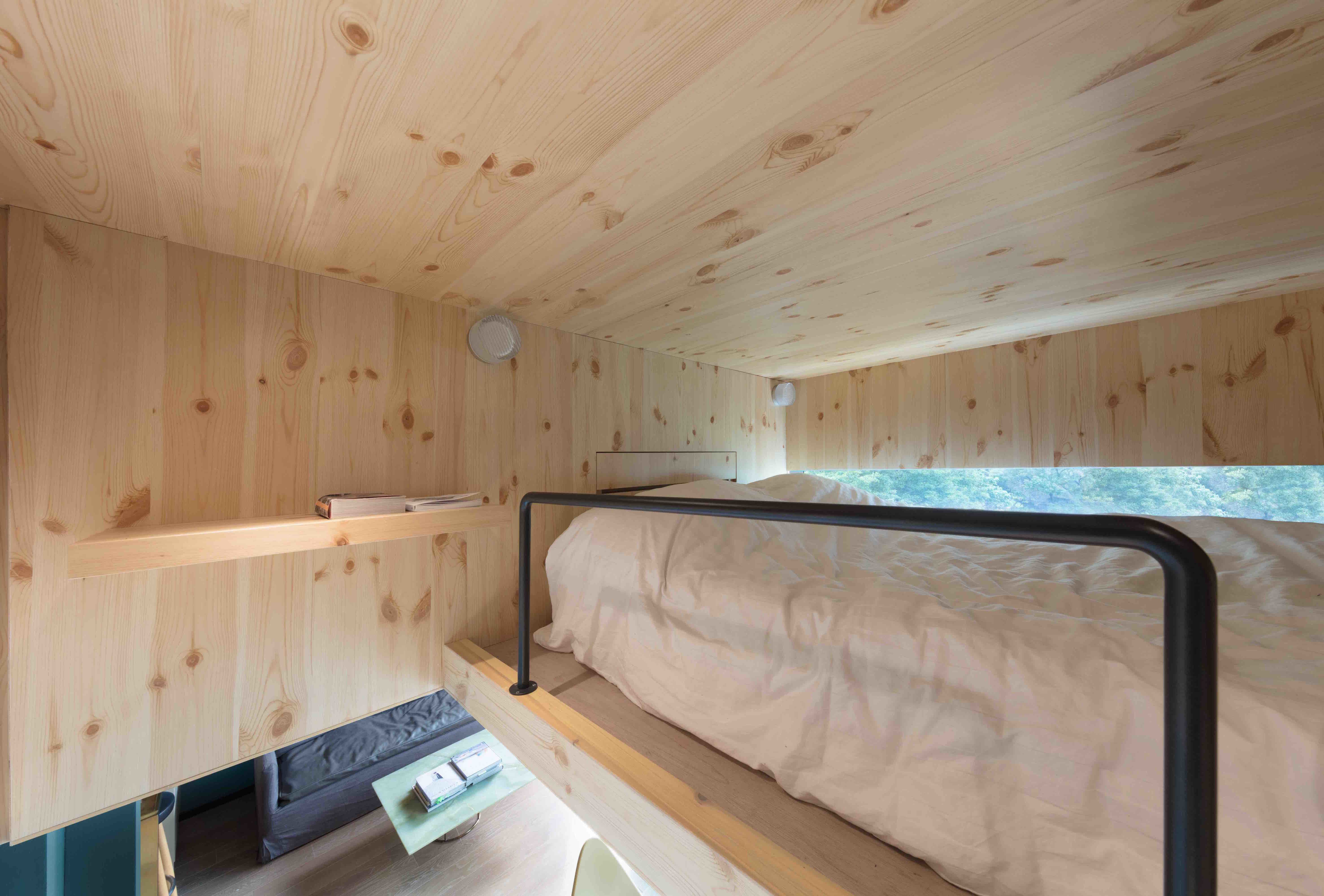 Mini loft bed with slide  Photo  of  in A Tiny Hong Kong Apartment With a Tree House