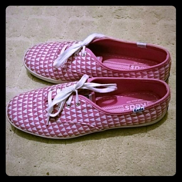 Pink polka dot keds Pink polka dot Keds, I don't believe they sell this style anymore. Only worn once. No damages, worn with socks on. Size 9.5. I sized up according to recommendations on the website but it actually fits true to size so it's a tad big for me. keds Shoes Sneakers