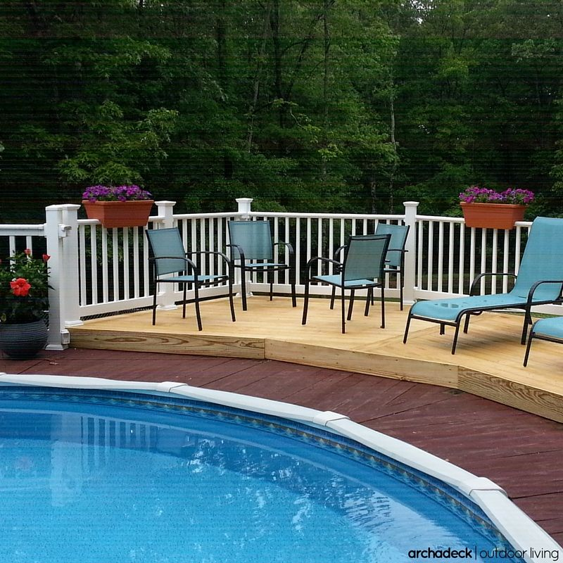 Surrounded By A White Vinyl Rail This Pressure Treated Pool Deck Is Attractive And Affordable Vinyl Railing Vinyl Deck Deck Photos