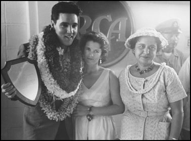 Elvis Poses with Fan in Hawai'i Elvis poses with a fan during a 1961 press conference in Hawai'i.