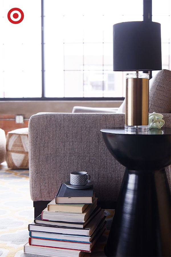 Nothing Says Luxe Living Room Like A Black Drum Table