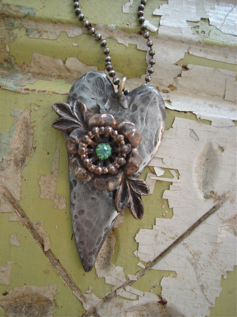 just the nicest balance of mixed metals, chippy background and pale green rhinestone.