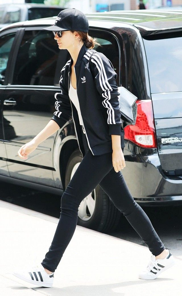 ba5d8435a441 Lily Aldridge steps out in a head to toe Adidas inspired look. The model  paired a tracksuit jacket with black jeans and superstar sneakers