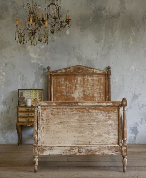 Love the subtle paint treatment on wall and weathered bed ...