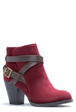 PERRI - ShoeDazzle. This basic bootie is anything but. Adorned in one of the season's top trends - wrapped straps - it gives off some much-needed attitude. Pair it with cropped pants to emphasize the silhouette.