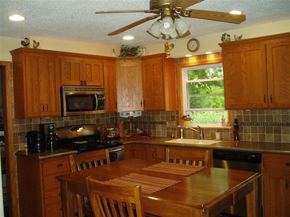 Custom Oak Cabinets With Laminate Top And Undermount Sink. Also Includes  Slate Floor, Standard