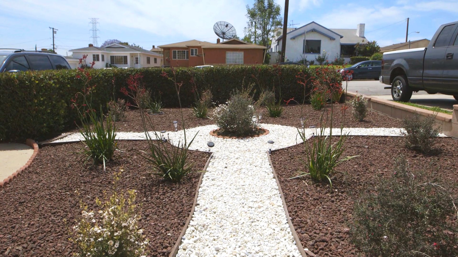 homeowners are replacing water thirsty green grass with more eco friendly alternatives from rocks to native shrubs
