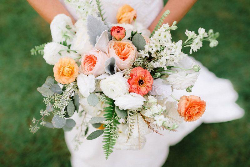 White Garden Rose bridal bouquet of white garden roses, white ranunculus, peach