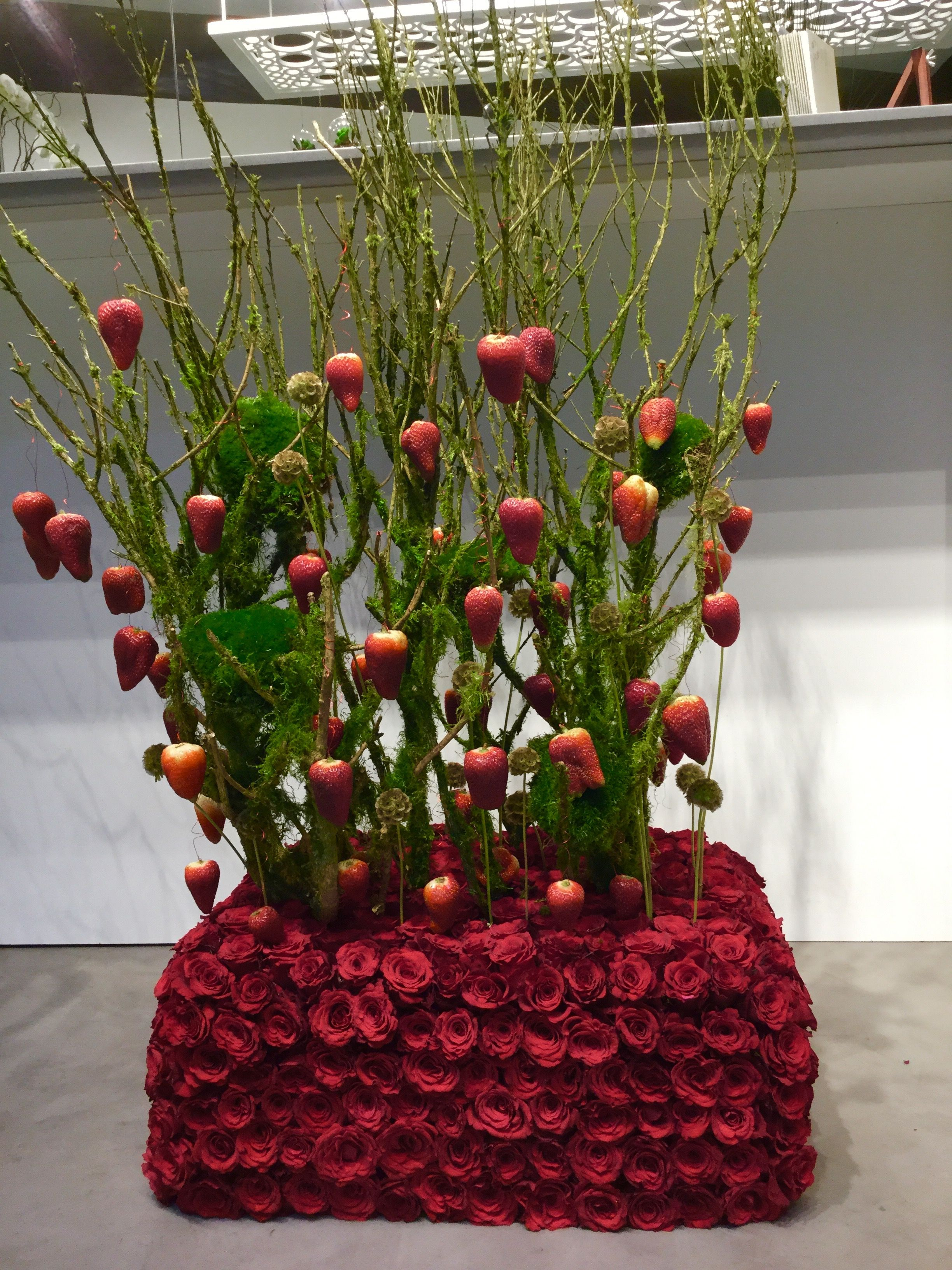 A unique composition of Fruits & Flowers created by