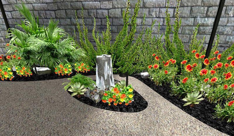 Modelo de jardin con flores y fuente pilar sobre piedras for Decoracion de jardines con piedras y plantas