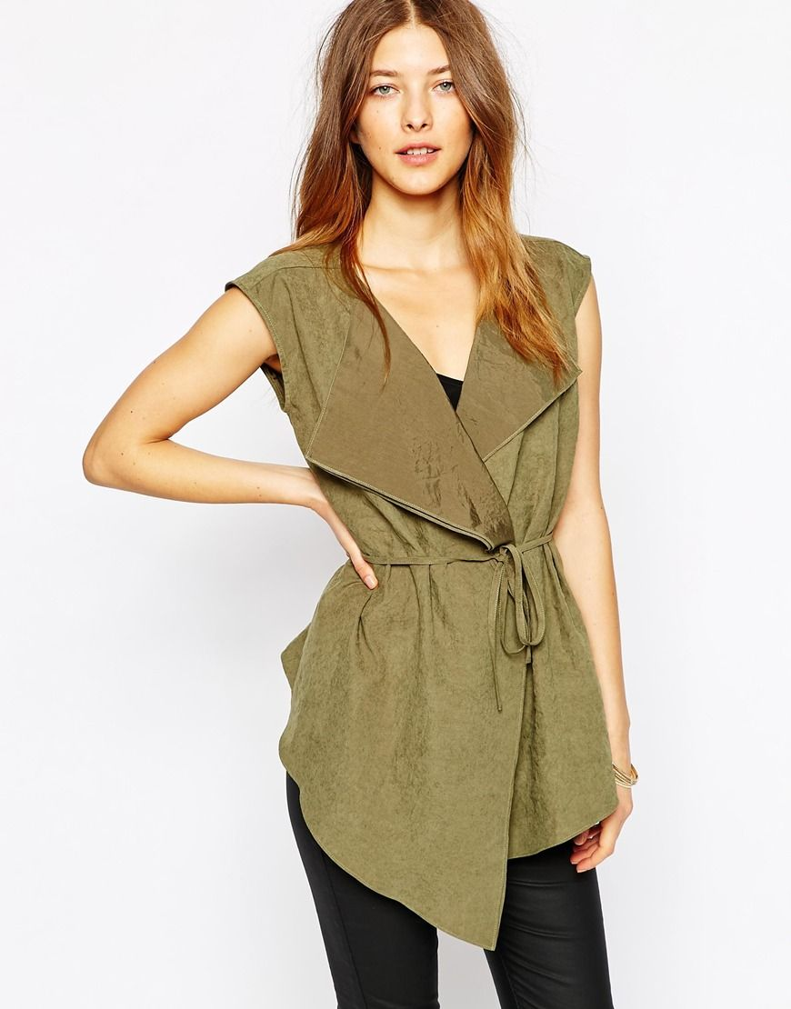Pair this sleeveless jacket with black skinnies, a black cami, and black peep toe booties.