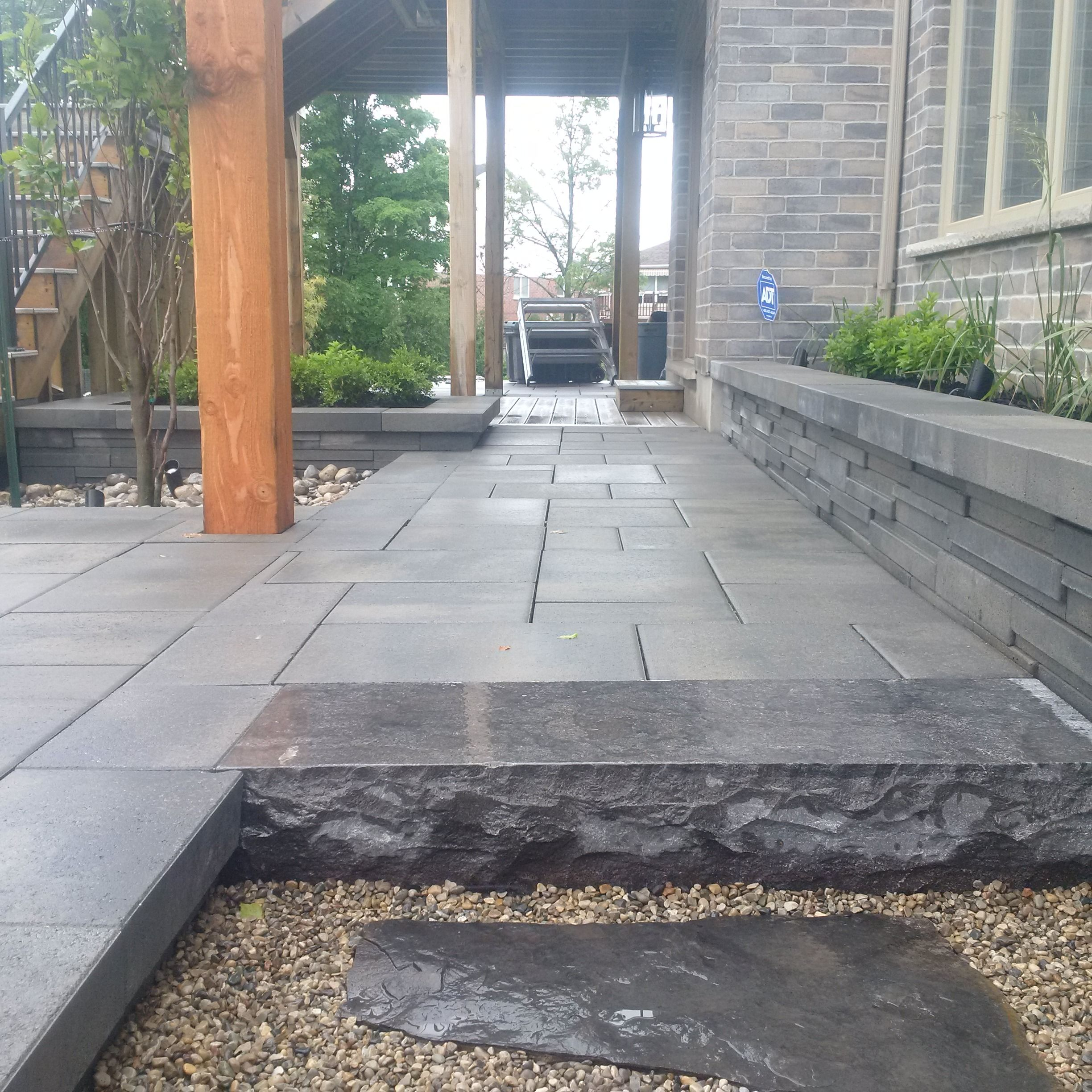 Check out this finished lower patio by Platinum Stone Design. Hampton Limestone Step and Rinox Solino Wall