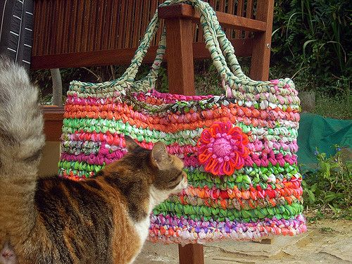 made from used clothes, bed seets, plastic bags and yarn.