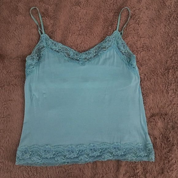 New York & comp intimates top Turquoise Ny & comp intimates tank top. Super soft , has bra top inside & adjustable straps. No rips or stains only worn once Tops Camisoles