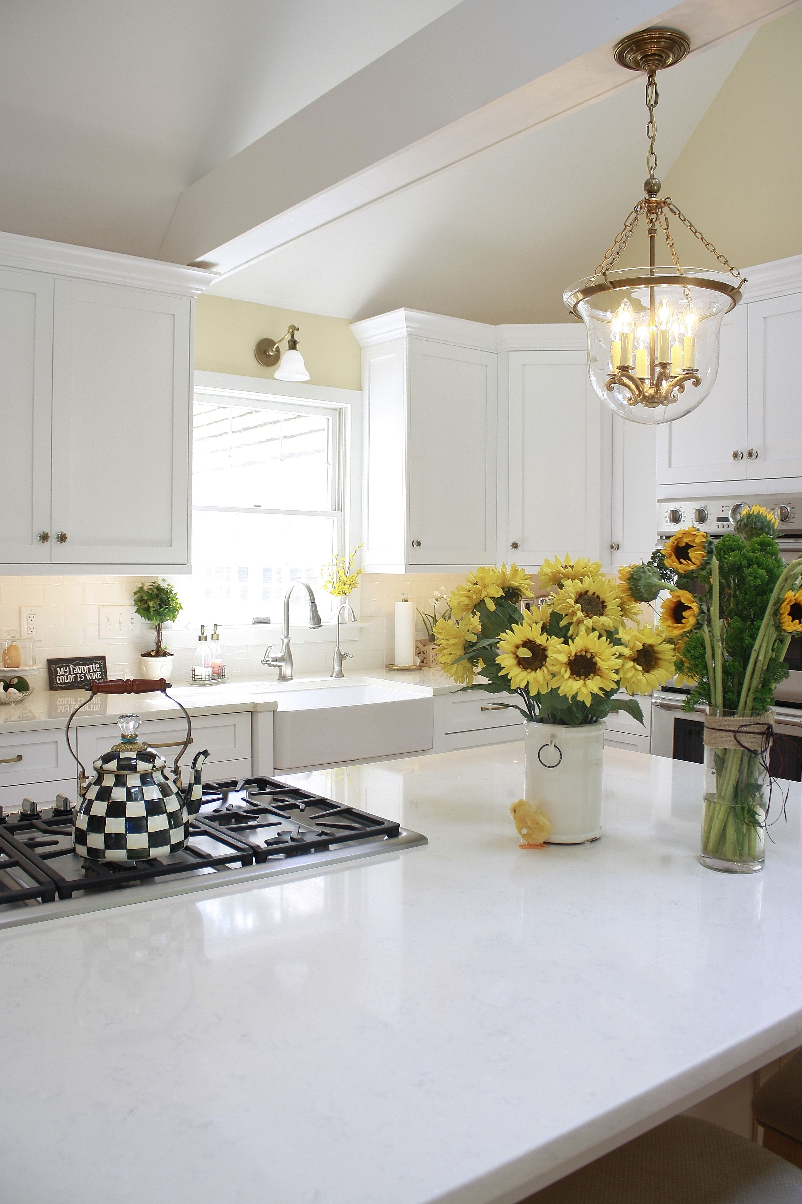 This beautiful white kitchen features Compac Perlino (an ...