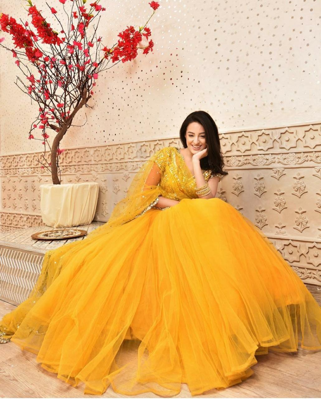 Beautiful ensemble of haldi yellow goodness by Abhinav