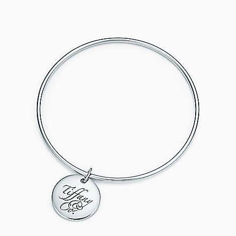 """Tiffany Notes """"Tiffany & Co.®"""" round tag bangle, medium."""