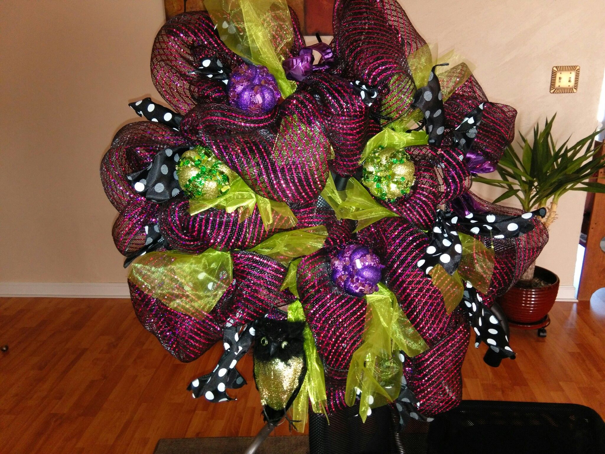 owl wreath with purple and green pumpkins