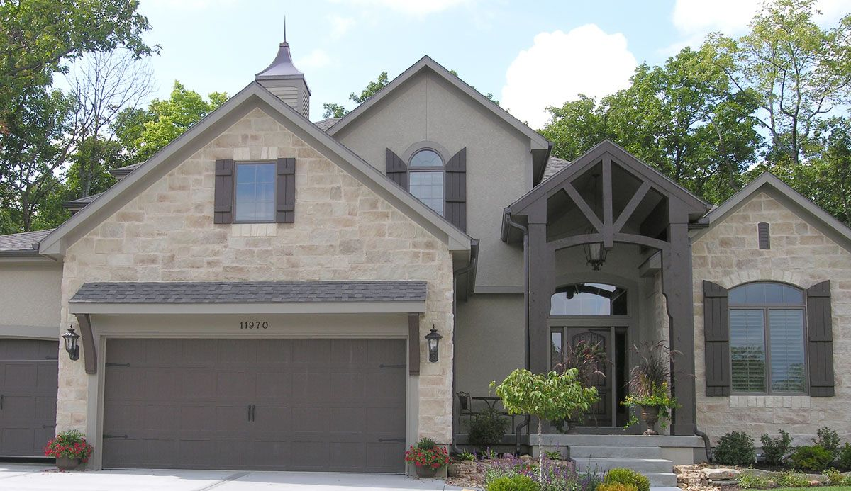 cream brick instead lt green taupe stucco and drk green taupe trim and doors my home