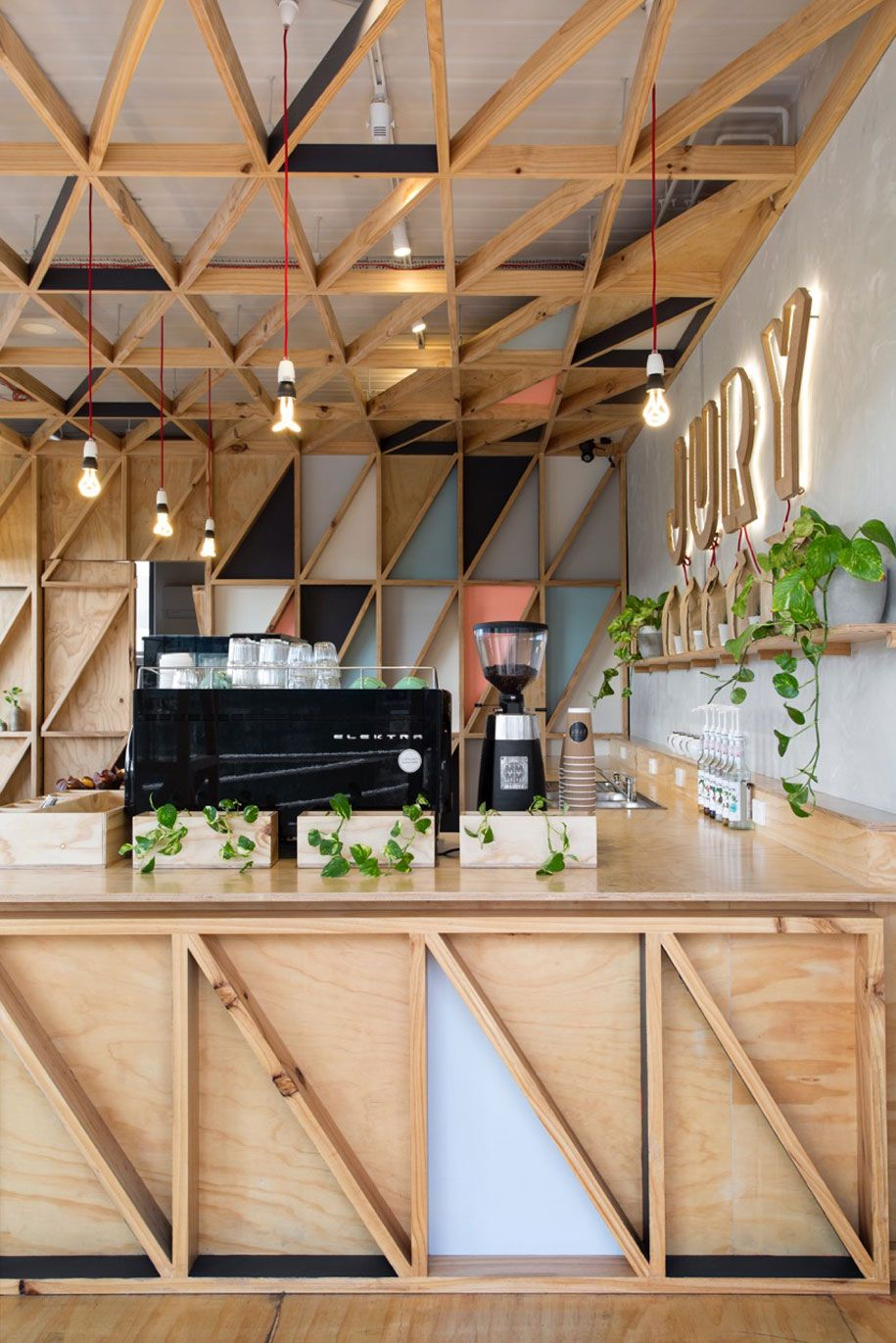 plywood details australian prison converted into a cafe lined with colourful tessellating triangles