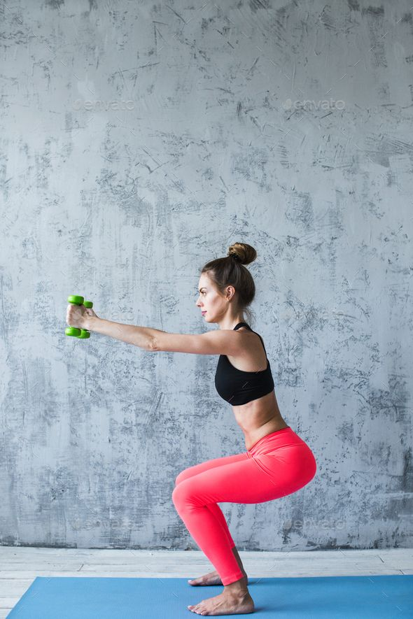 Fitness woman with dumbbells doing exercises. by MediaGroupBestForYou. Fitness woman with dumbbells...