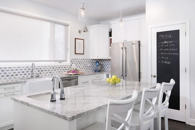 Stunning Kitchen Features White Shaker Cabinets Paired With Super White  Quartzite Countertops And .