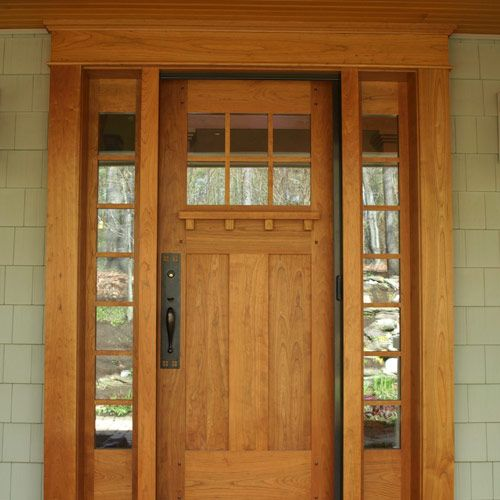 Cherry entry door accented by craftsman hardware for Door hardware ideas