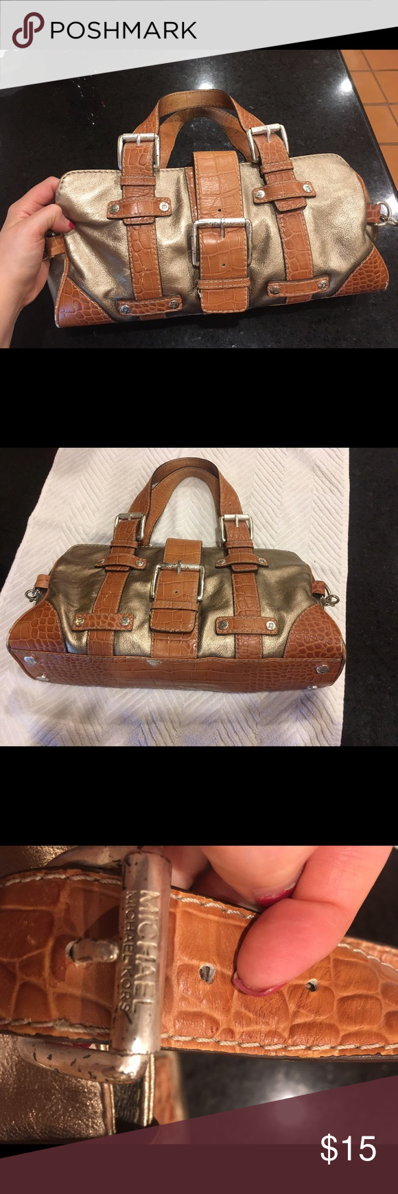 Michael Kors purse Michael Kors small gold metallic satchel with crock print leather. Silver studding and detailing.  Clean inside and ready for an adventure.  Lots of wear, but lots of life left. Offers welcome. MICHAEL Michael Kors Bags Satchels