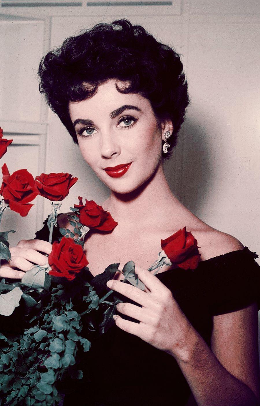 Elizabeth Taylor arranging a bouquet of red roses, 1953 ...