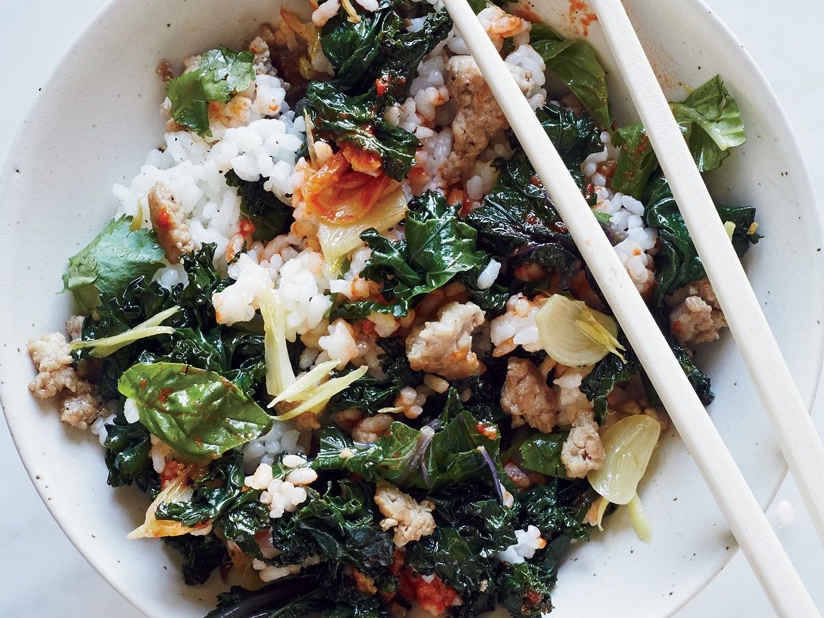 Kale Rice Bowl   The combination of pork and kale in this simple rice bowl is hearty and satisfying, while the abundance of herbs makes it delightfully fresh-tasting as well.