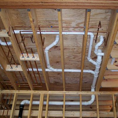 New water pipes and drainage installed under floor in home for Pex vs copper cost