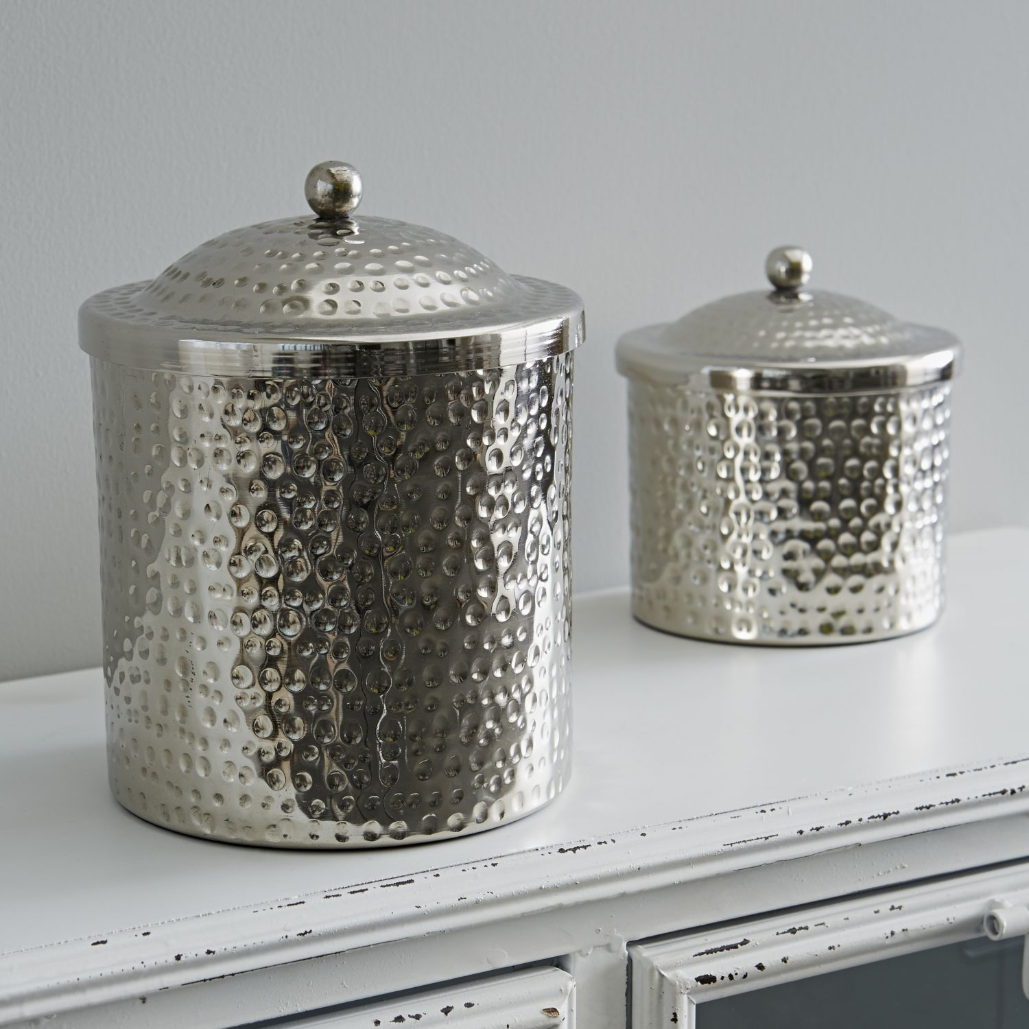 Rigby & Mac Beaten Silver Canisters Small: Smart dimpled metal canisters to hold all manner of things. The small size is perfect for baby buds while the large could be a pretty table top bin for the bathroom. These would look equally good in the living room or bedroom. Velvet bottom so will not scratch or discolour your surfaces.- metal