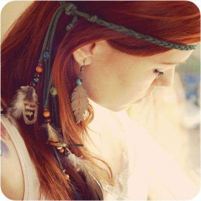Braided headpieces aligned with feathers