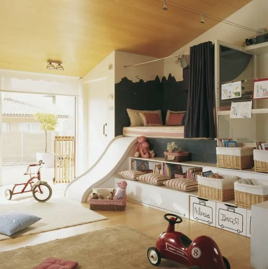 great idea for a play room: reading nook, lots of toy storage and a fun 'slide' ...