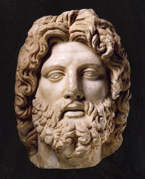 head of Serapis Ammon, marble, Roman Imperial, circa 2nd half of the 2nd Century A.D., 13 1/4 inches high