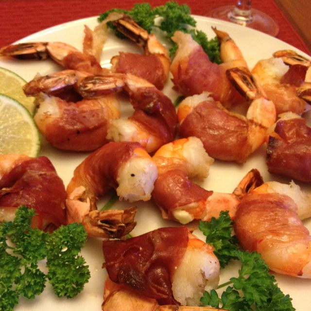 Prawns and feta cheese wrapped in prosciutto, grilled, and drizzled with lemon.  Num.  MK