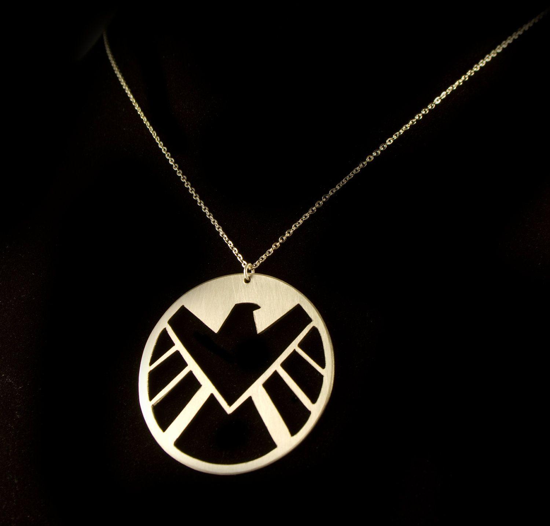 S.H.I.E.L.D.  Necklace. I don't know about you guys but I am a HUGE S.H.I.E.L.D.  junky