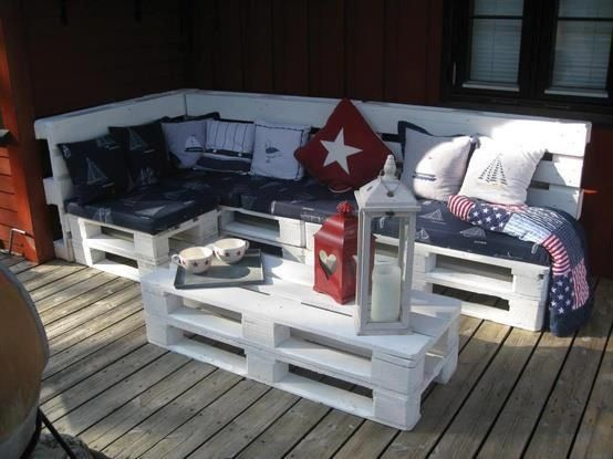 Pallets painted white, with cushions atop