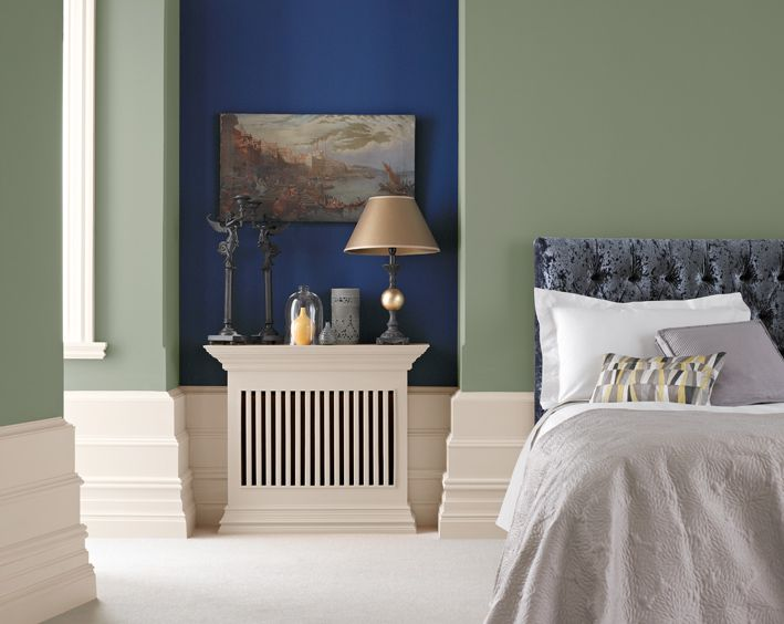 Stylish bedroom painted with Crown Period Colours in Ballgown (blue) and Promenade (green)
