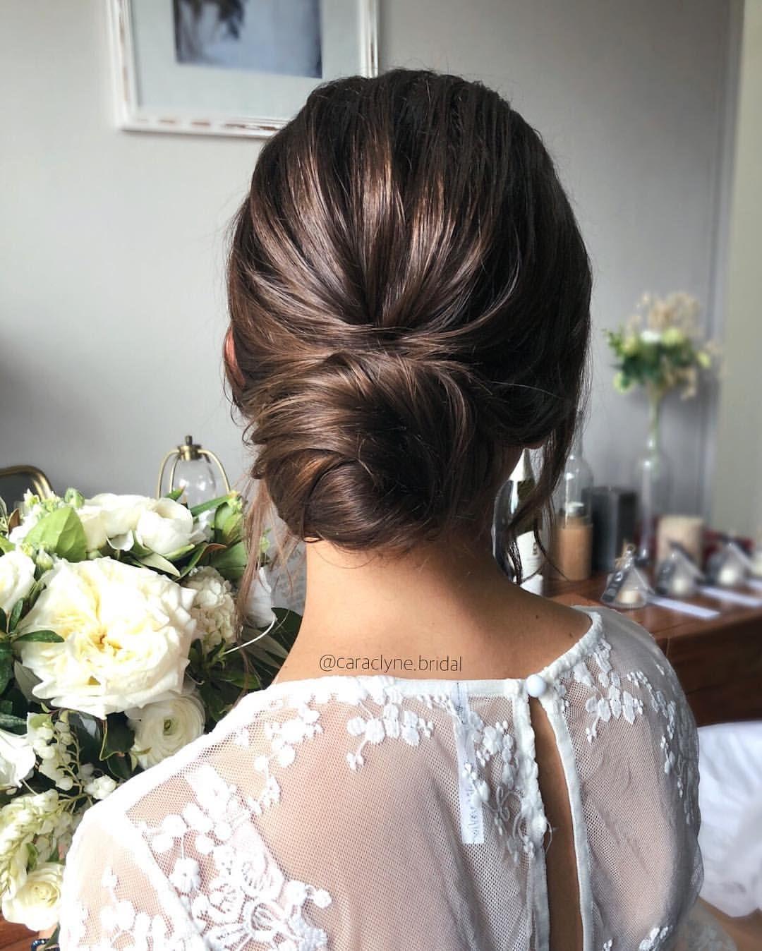 showcasing beautiful texture on this dark hair updo
