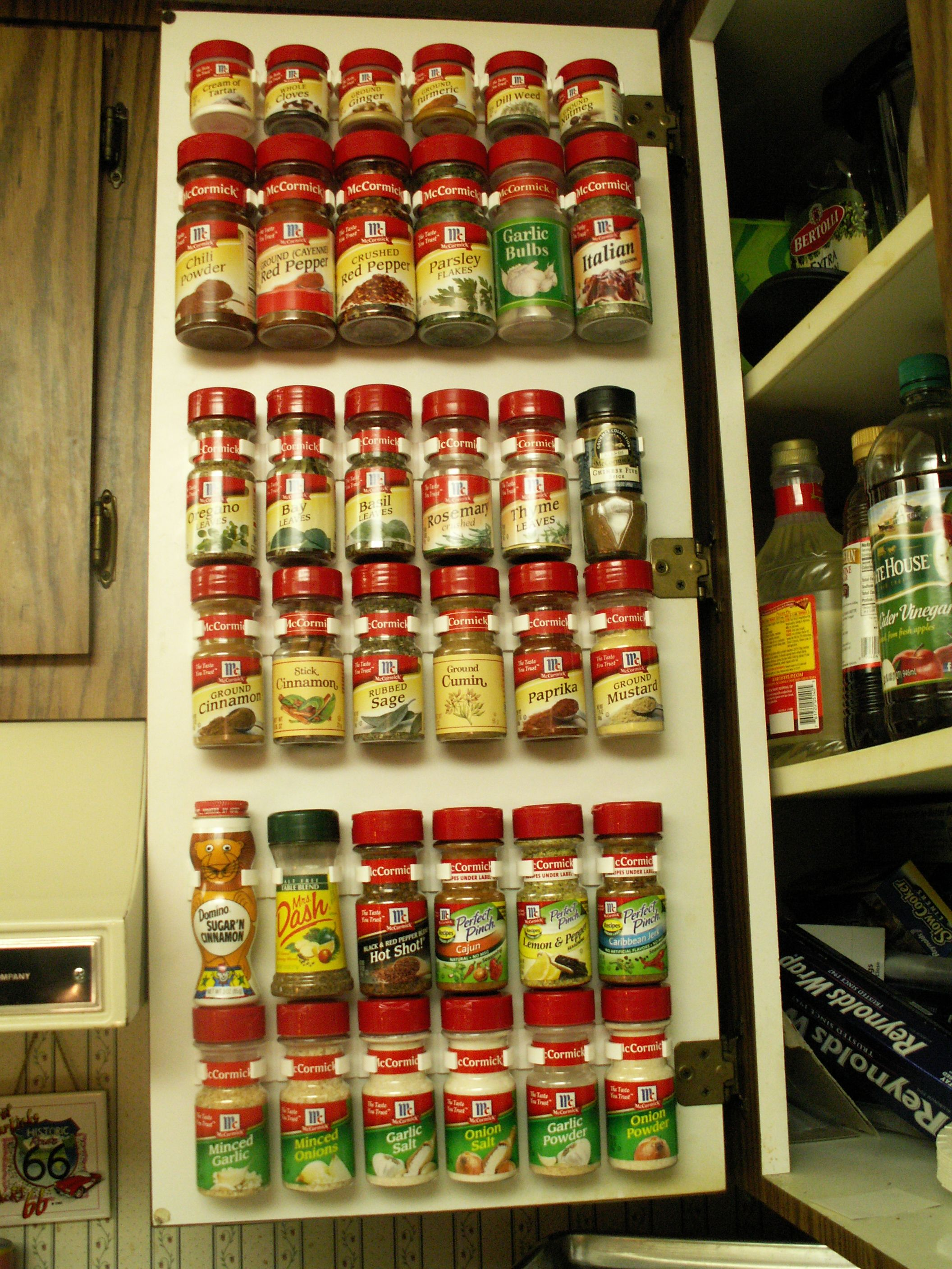 spice rack on the inside of a kitchen cabinet door i did this in my rh pinterest com inside cabinet door spice rack inside kitchen cabinet spice rack