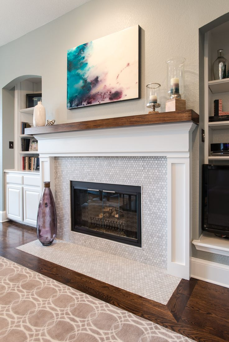 white marble fireplace with hexagon pattern house family room