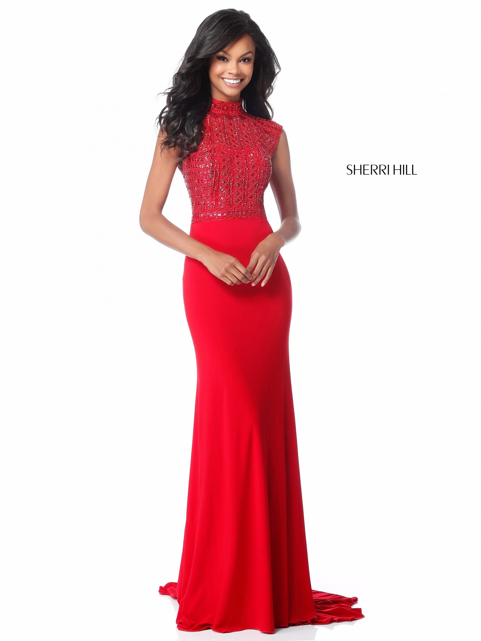 This sherri hill red formal gown features a fitted silhouette