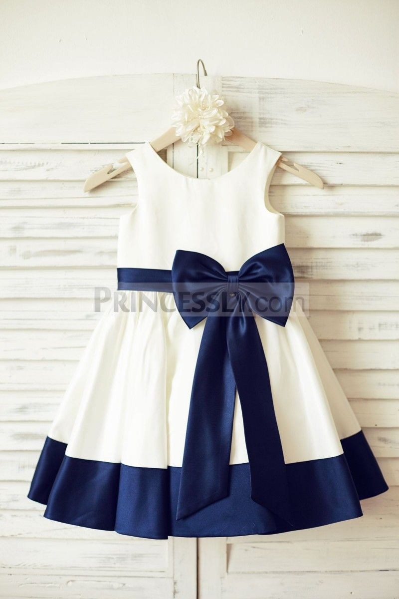 Ivory satin flower girl dress with navy blue beltbow wedding
