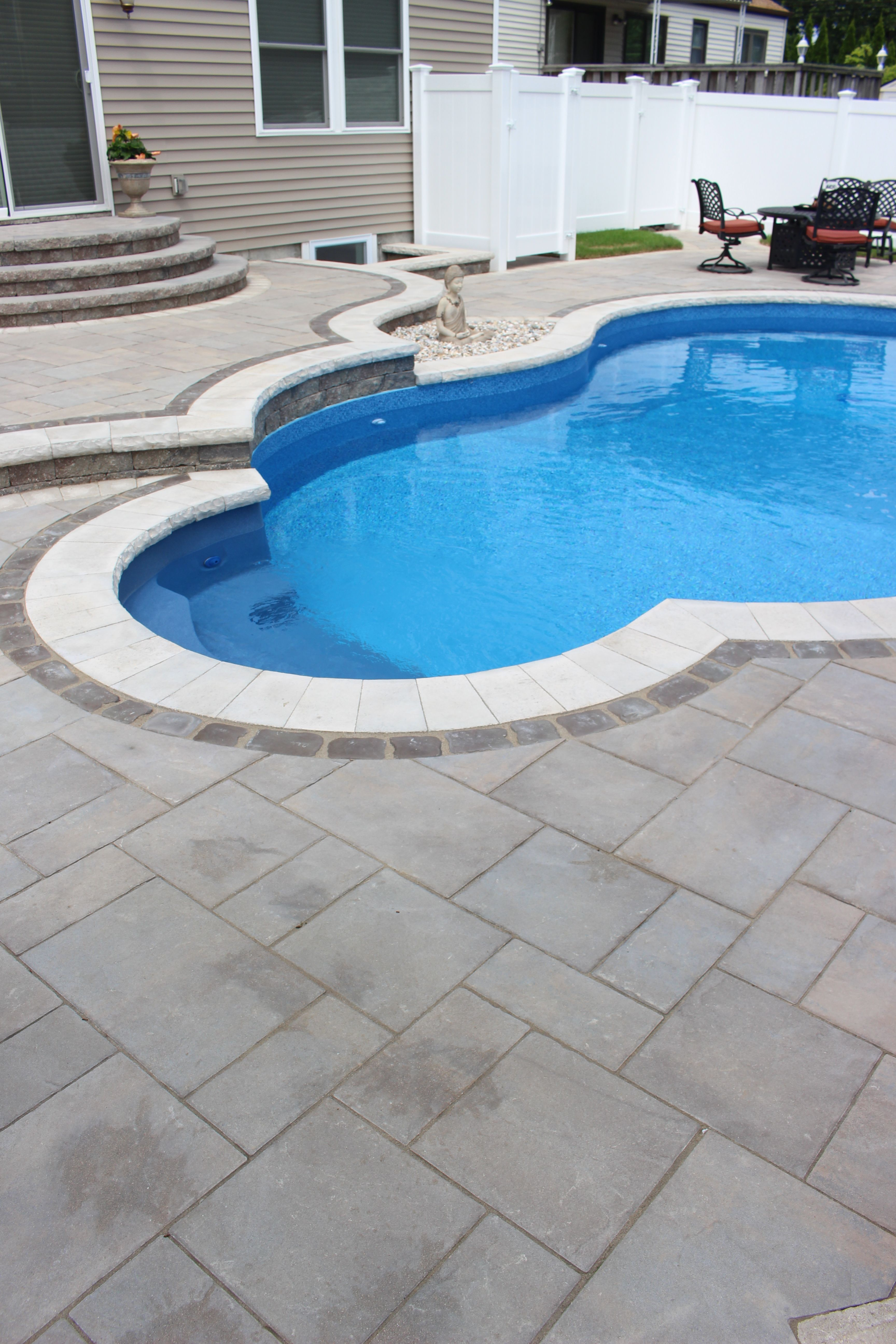 This Massapequa Ny Pool Patio Built With Beautiful Unilock Pavers Is Clean And Modern Yet Wonderfully Organic Thank Pool Patio Pavers Pool Decks Pool Patio