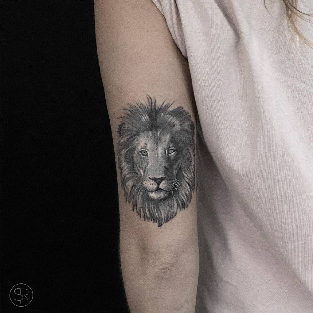 Lion Head Tattoo On The Back Of The Left Arm.