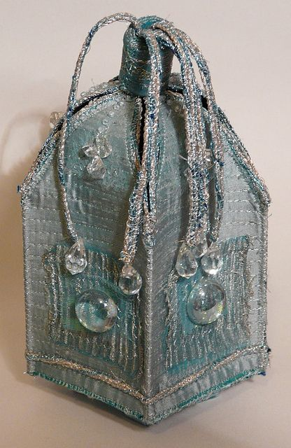 Sea-green pyx shaped box, silk and organza, embellished with glass stones and rock crystal.  2005