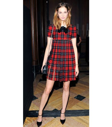 @Who What Wear - Laura Love, model  Alexa Chung has figured out how to pull off the schoolgirl shtick into her 30s, but for the rest us, your 20s are the ideal time to rock the nymphet look. Love nails the look by aligning her accessories, like a cheeky neck-tie and mary-jane heels, with the youthful vibe of the plaid babydoll dress.
