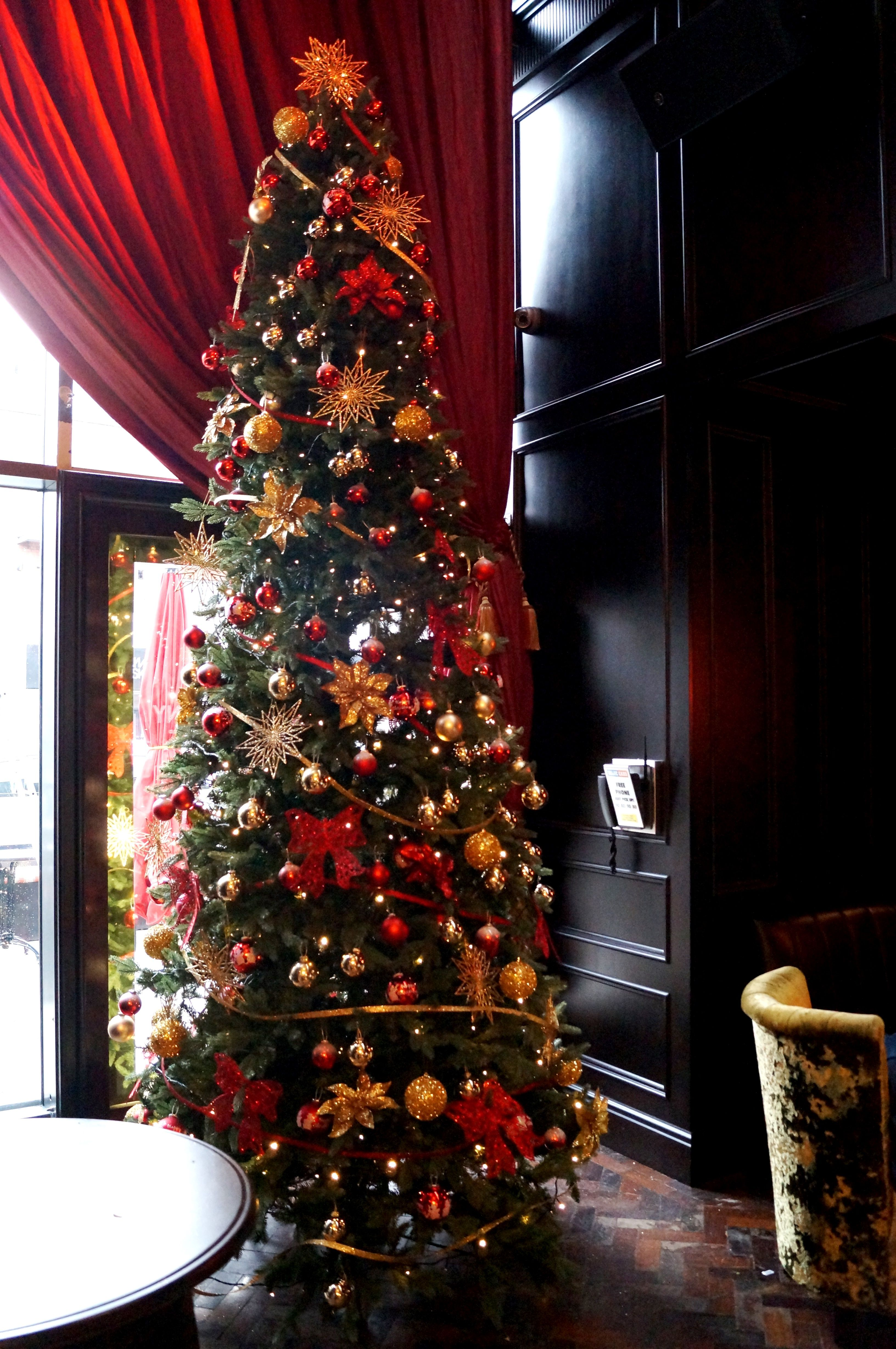 A 12ft luxury Christmas tree with red and gold decor and